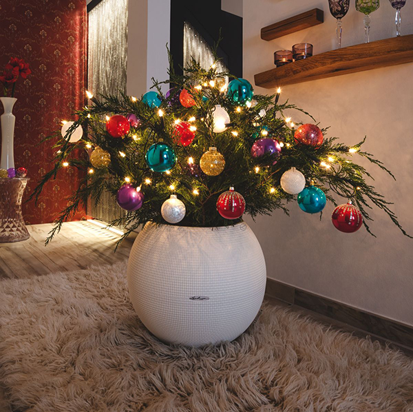 Christmas tree with balls in a pot